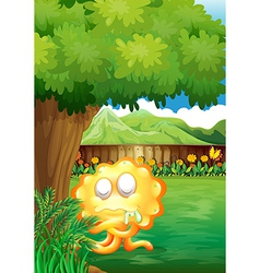 A yellow monster under the tree in the gated yard vector