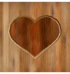 Grunge heart carved into wooden plank EPS8 vector image vector image