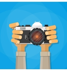Hands holding photo camera vector image vector image