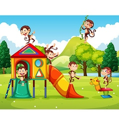 Monkeys playing in the playground vector image