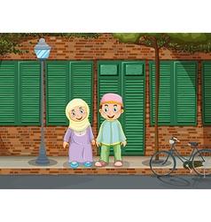 Muslim couple standing on the sidewalk vector