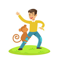 Cute happy boy standing and playing with monkey vector