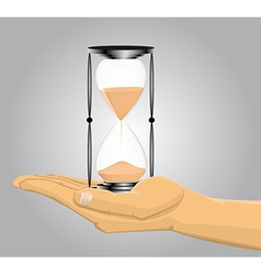 Hand holding a sandglass vector image vector image