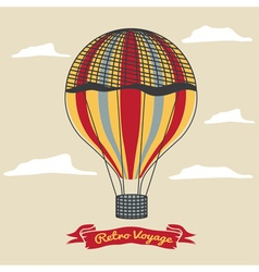 Vintage hot air balloon in the sky with clouds vector