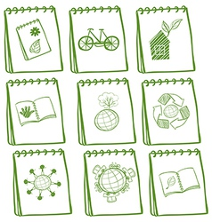 Notebooks with green drawings at the cover page vector image