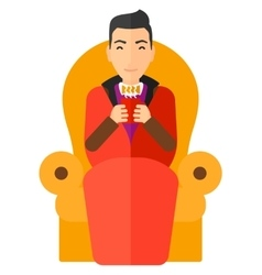 Man sitting in chair with cup of tea vector
