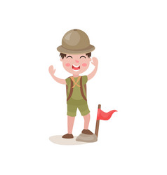 boy scout standing with one foot on stone near vector image