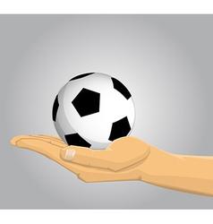 Hand holding a soccer ball vector