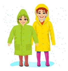 brother and sisiter wearing raingcoats vector image