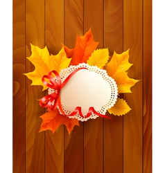 Card with leaves with a bow on wooden background vector