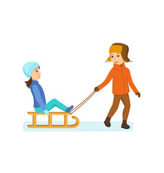Boy rolls girl on plain dressed in winter clothes vector