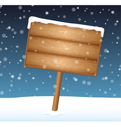Sign on snow meadow with falling snow vector