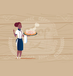 Female african american chef cook holding pizza vector