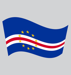 Flag of cape verde waving on gray background vector