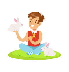 Smiling boy sitting on green grass playing and vector
