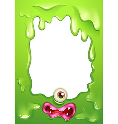 A green border template with a monsters eye and vector image