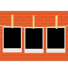 Photos over brick wall vector