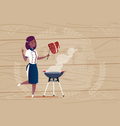 Female african american chef cook grilling meat vector