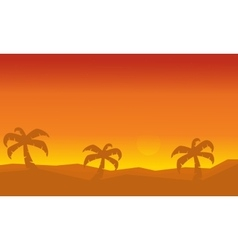 Silhouette of palm on dessert scenery vector