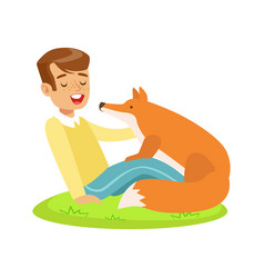 Smiling boy sitting on green grass and petting red vector