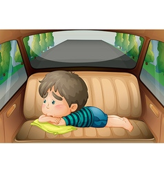 Sad boy in the back of the car vector image