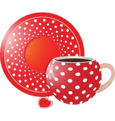 Red with white dots cup and saucer vector