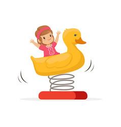 cheerful toddler girl having fun on yellow plastic vector image