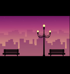 Street lamp with chair beauty scenery silhouettes vector