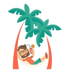 Young man on th beach relaxing and drinking vector image