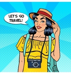 Young pretty female tourist with camera vector
