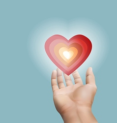 Red heart floating on hand with purple background vector image