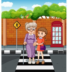 Girl and old lady crossing the road vector image
