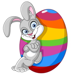 Bunny with easter egg vector