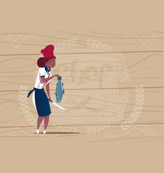 Female african american chef cook holding fish vector