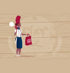 Female african american chef cook holding bag with vector