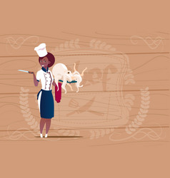 Female african american chef cook holding octopus vector