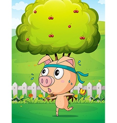 A pig exercising near the tree vector