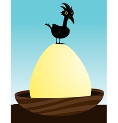 Bird on large egg vector