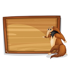 A wild animal beside an empty wooden board vector image vector image