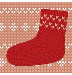 Red knitted sock on seamless pattern vector