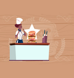 female african american chef cooking big burger vector image vector image