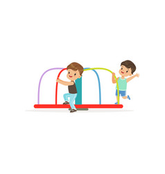 Two preschool boys playing on rotating roundabout vector