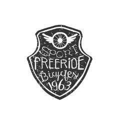 Freeride vintage badge with winged wheel vector