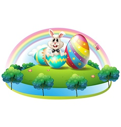 A bunny inside the easter egg vector image