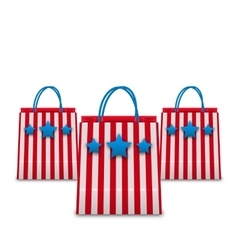 Shopping bags in american patriotic colors vector