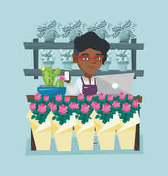 Florist standing behind the counter at flower shop vector
