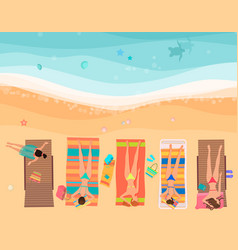 Young women lying on the beach near sea top view vector