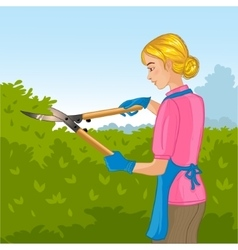 Woman trimming a bush or tree with big clippers vector