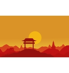 Silhouette of pavilion on hill at sunset vector