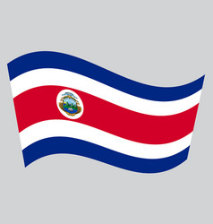 Flag of costa rica waving on gray background vector